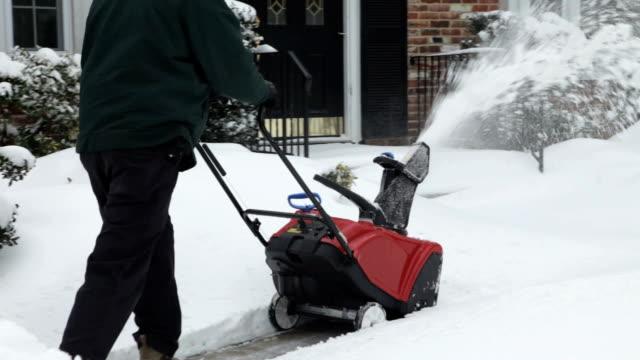 Snowblower Clearing Sidewalk in Winter (Video)
