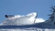 Snowboarder does a snow spray