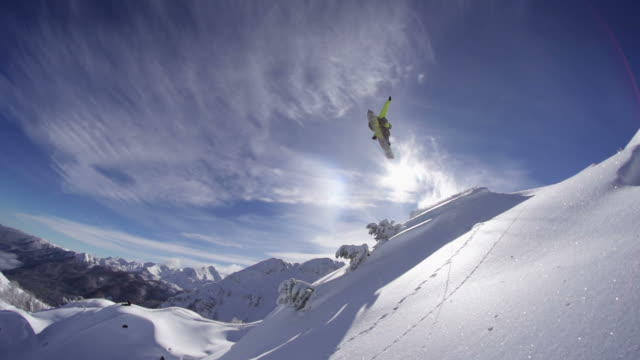 Snowboarder jumps on freshly fallen snow