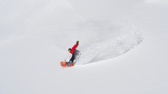Snowboarder making a turn in fresh snow