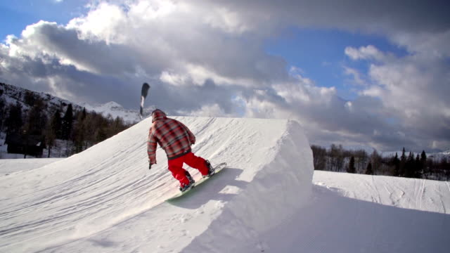 Snowboarder performs a trick in a snowpark
