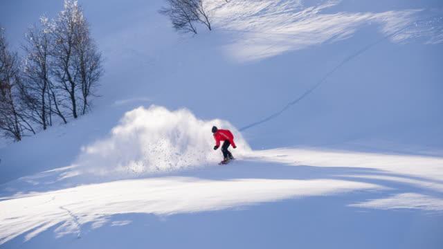 Snowboarder powder snow turn
