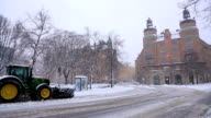 Snowcat, Snow bulldozer, clear snowfall from road Stockholm Sweden
