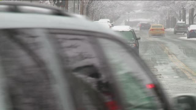 Snowfall in New Jersey Cars Driving on an Icy Street on December 10 2013 in Jersey City New Jersey