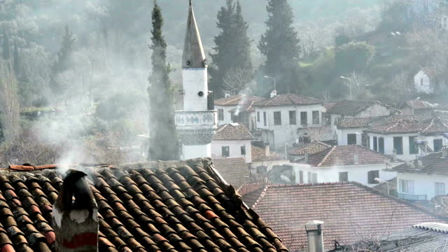 Snowing and smoke in the chimney in Şirince village