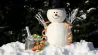 snowman with ice bucket and streamer