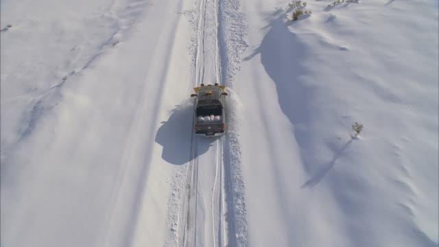 WS POV TU Snowplow in mountains / Mammoth Lakes, California, USA