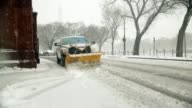 Snowplows clean up snow outside the Smithsonian Castle at the National Mall during a snowstorm Washington DC March 6 2015