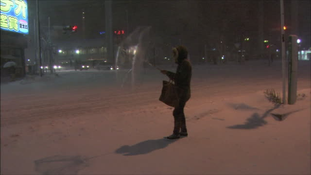 Snowstorm Person holding a plastic umbrella turned inside out by the strong wind