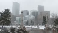 Snowy Civic Center Park with Downtown Denver skyline Colorado winter