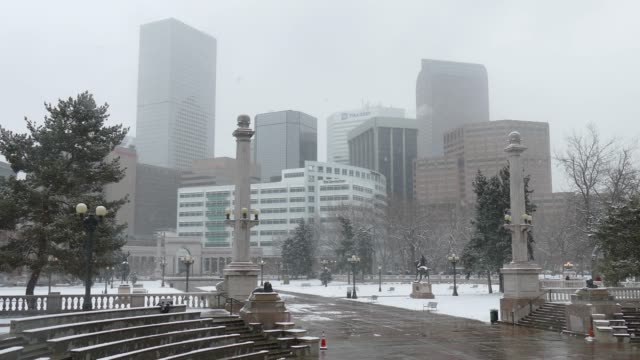 Snowy Civic Center Park with Downtown Denver skyline Colorado winter