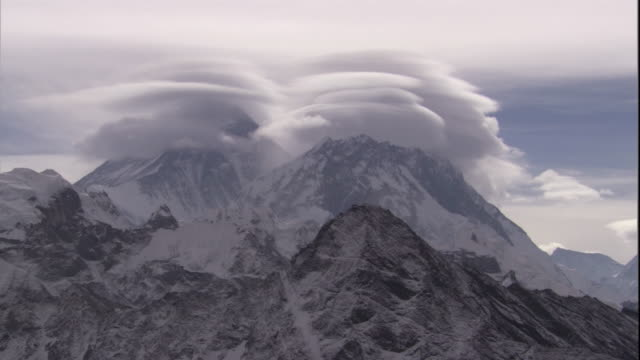 Snowy cloud-shrouded peaks, Himalayas, Nepal Available in HD