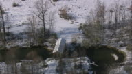 AERIAL Snowy covered bridge over stream / Vermont, United States