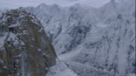 Snowy peaks surround a glacier in the Karakoram Range, Pakistan. Available in HD.