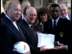 New trial scheme 540pm ENGLAND London Westminster Denis Howell with leaders of football players assoc as pose for press holding petition Intvw Gordon...