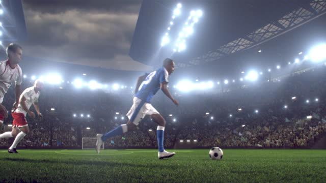 Soccer player kicks a ball on stadium