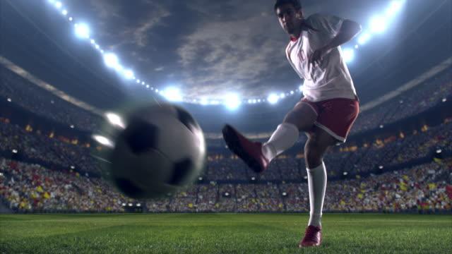 Soccer player kicks a penalty
