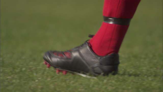 CU PAN Soccer player placing ball and walking backwards, then runs and kicks it / Sheffield, England, UK