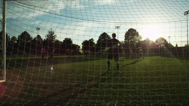 WS PAN SLO MO Soccer player scoring goal into net / Provo, Utah, USA