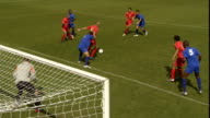 HA WS Soccer players kicking ball from corner of field during game/ Goalie deflecting attempt to score/ Sheffield, England