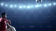 Soccer players kicking ball in stadium