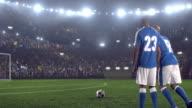 Soccer players make a kick