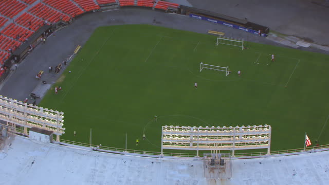 WS ZO AERIAL POV Soccer players practicing on field in RFK Stadium / Washington DC, United States