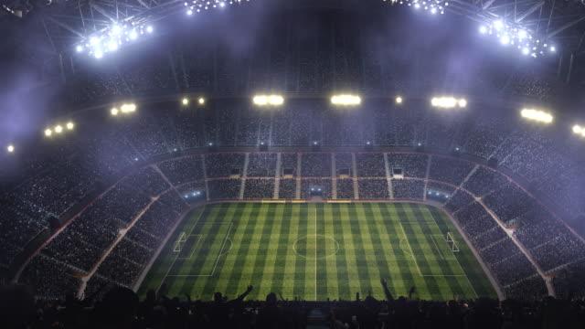 Fotbollsstadion med dimma och lampor