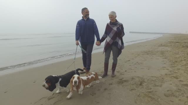 Social Seniors Mature Couple at Beach