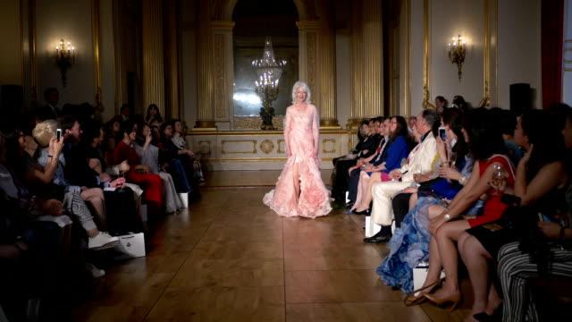 Socialite Joan Darbyshire on Grace Chen fashion catwalk show at Lancaster House London on June 11 2016