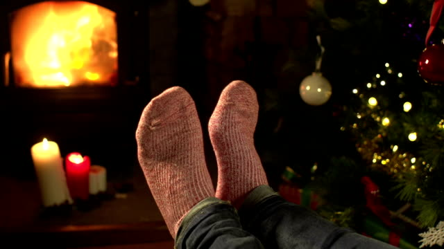 Socks, Feet relaxing in front of a Fire at Christmas