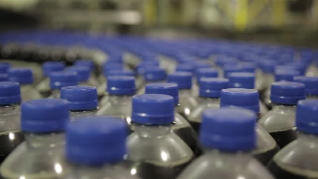 CU soda bottles on bottling line / soda and beverage manufacturing