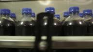Soda bottles on manufacturing line / soda bottling plant.