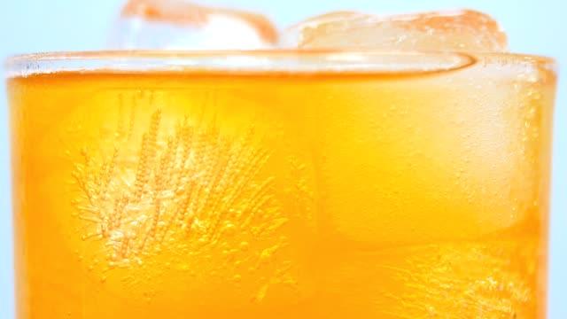 soft drink orange close-up white background