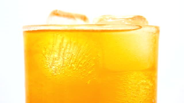 soft drink orange drinking glass white background