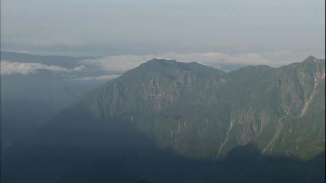 Soft sunlight shines on Japan's Mount Kasa.