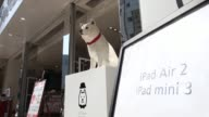 Softbank signage above entrance to store Pedestrians walk past a SoftBank Corp store in the Ginza district during the sales launch of Apple Inc's new...