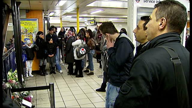 silent vigil at Victoria Tube Station ENGLAND London Victoria Tube station INT People attending silent vigil in memory of Sofyen Belamouadden Floral...