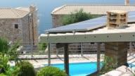 Solar panels on house in Sivota, Greece.