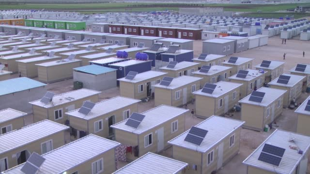 Solar power panels have been installed on the container shelters to generate electricity at Sijju refugee camp in the Azez district of Aleppo Syria...