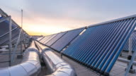 solar water heater and tubes at sunset time lapse