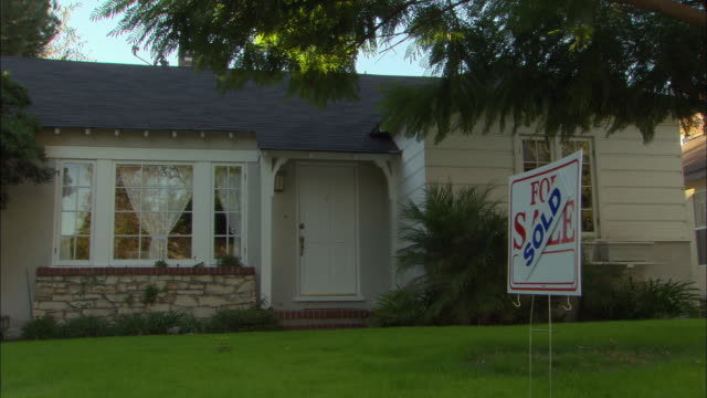 MS, 'Sold' sign in front of suburban house, Studio City, Los Angeles, California, USA