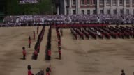 A soldier appears to faint during the Trooping the Colour ceremony at Horse Guards Parade Shortly afterwards another soldier also went down