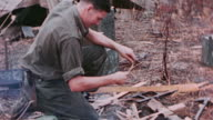 ANZAC soldier building campfire / the Philippines