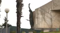 A soldier carrying the flame of freedom adorns the Monument of the Martyrs of the Algerian War. Available in HD.