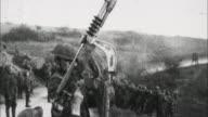 Soldier firing machine gun and heavy artillery fires / France