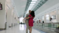 WS Soldier hugs wife in airport