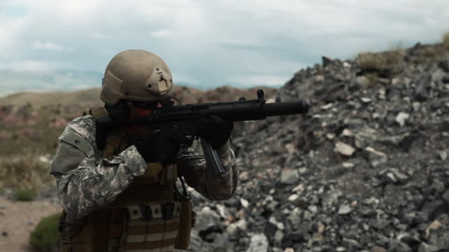 Soldier shooting automatic small target rifle at range single fire.