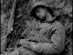 Soldier sleeping with rifle next to him / Soldier leaning against tree writing letter
