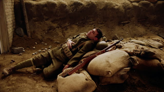 TD WS soldier suffering from wound in a trench
